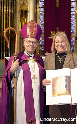 Bishop George Leo Thomas and Linda McCray holding the Diocese of Helena Book of the Elect